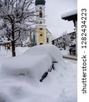 snowbound car in snowy reit im...   Shutterstock . vector #1282434223