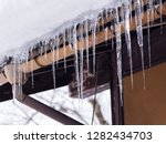 sharp icicles and melted snow... | Shutterstock . vector #1282434703