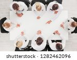 business people sitting around... | Shutterstock . vector #1282462096