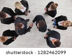 top view of a strong handshake... | Shutterstock . vector #1282462099