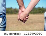 romantic couple with clasped... | Shutterstock . vector #1282493080