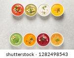 various cream soups in bowls... | Shutterstock . vector #1282498543