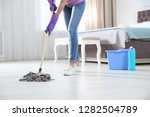 young woman washing floor with... | Shutterstock . vector #1282504789