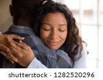 happy african american wife... | Shutterstock . vector #1282520296