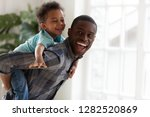 excited kid boy playing with... | Shutterstock . vector #1282520869
