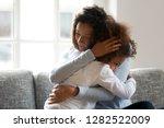 loving single black mother... | Shutterstock . vector #1282522009