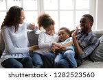 happy black family laughing... | Shutterstock . vector #1282523560