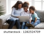 black family mom with 2 kids... | Shutterstock . vector #1282524709