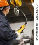 worker holding crane hook... | Shutterstock . vector #128253710