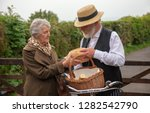 1940s delivery man and elderly... | Shutterstock . vector #1282542790