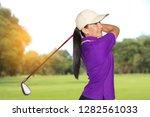 asian golfer woman hit shot... | Shutterstock . vector #1282561033