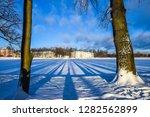 winter sunset river landscape.... | Shutterstock . vector #1282562899