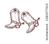 cowboy boots. shoes in hand... | Shutterstock .eps vector #1282577413