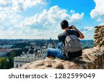 man with backpack taking photo... | Shutterstock . vector #1282599049