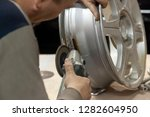 the repairman holds in his... | Shutterstock . vector #1282604950