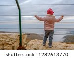 back view of little girl at the ... | Shutterstock . vector #1282613770