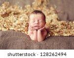 newborn baby boy on his elbows | Shutterstock . vector #128262494