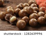 roasted macadamias on wooden... | Shutterstock . vector #1282639996