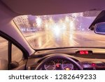rainy view from the car at... | Shutterstock . vector #1282649233