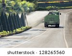 Water truck watering bush and shrub in park - stock photo