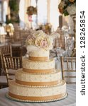 Wedding Cake With Roses At...