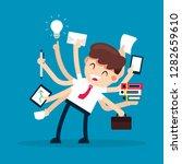businessman multitasking works... | Shutterstock .eps vector #1282659610