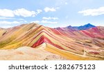 Small photo of Panoramic view of Rainbow Mountain at Vinicunca mount in Peru - Travel and wanderlust concept exploring world nature wonders - Vivid multicolor filter with bright enhanced color tones