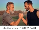 the father and son holding hands | Shutterstock . vector #1282718620
