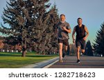 the father and son running on... | Shutterstock . vector #1282718623