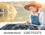 girl in winter sit write... | Shutterstock . vector #1282752373
