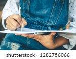 girl in winter sit write... | Shutterstock . vector #1282756066