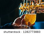 close up of bartender pouring... | Shutterstock . vector #1282773883