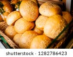 white round buns with sesame.... | Shutterstock . vector #1282786423