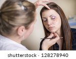 make up artist doing... | Shutterstock . vector #128278940