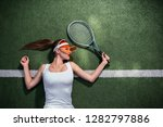 beautiful girl playing tennis...   Shutterstock . vector #1282797886