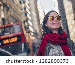 smiling girl in sunglasses on... | Shutterstock . vector #1282800373
