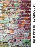 grunge colored brick wall... | Shutterstock . vector #1282803919