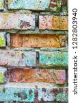 old grunge colored brick wall... | Shutterstock . vector #1282803940