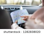 gril traveling by car on... | Shutterstock . vector #1282838020