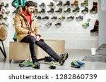 man in winter jacket trying...   Shutterstock . vector #1282860739