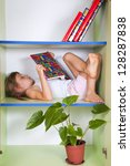 child reading a book and... | Shutterstock . vector #128287838