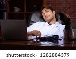 young handsome doctor working...   Shutterstock . vector #1282884379