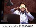young handsome doctor working...   Shutterstock . vector #1282884400