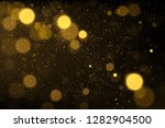 sparkling gold particles... | Shutterstock .eps vector #1282904500