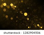 sparkling gold particles... | Shutterstock .eps vector #1282904506