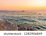 sunset above the boat on... | Shutterstock . vector #1282906849