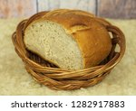 cut loaf of bread in the old... | Shutterstock . vector #1282917883
