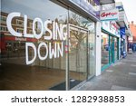 Small photo of LONDON- JANUARY, 2019: A vacant high street shop with 'closing down' sign in shop window