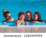portrait of a happy family... | Shutterstock . vector #1282949359