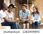 four laughing diverse people... | Shutterstock . vector #1282949893